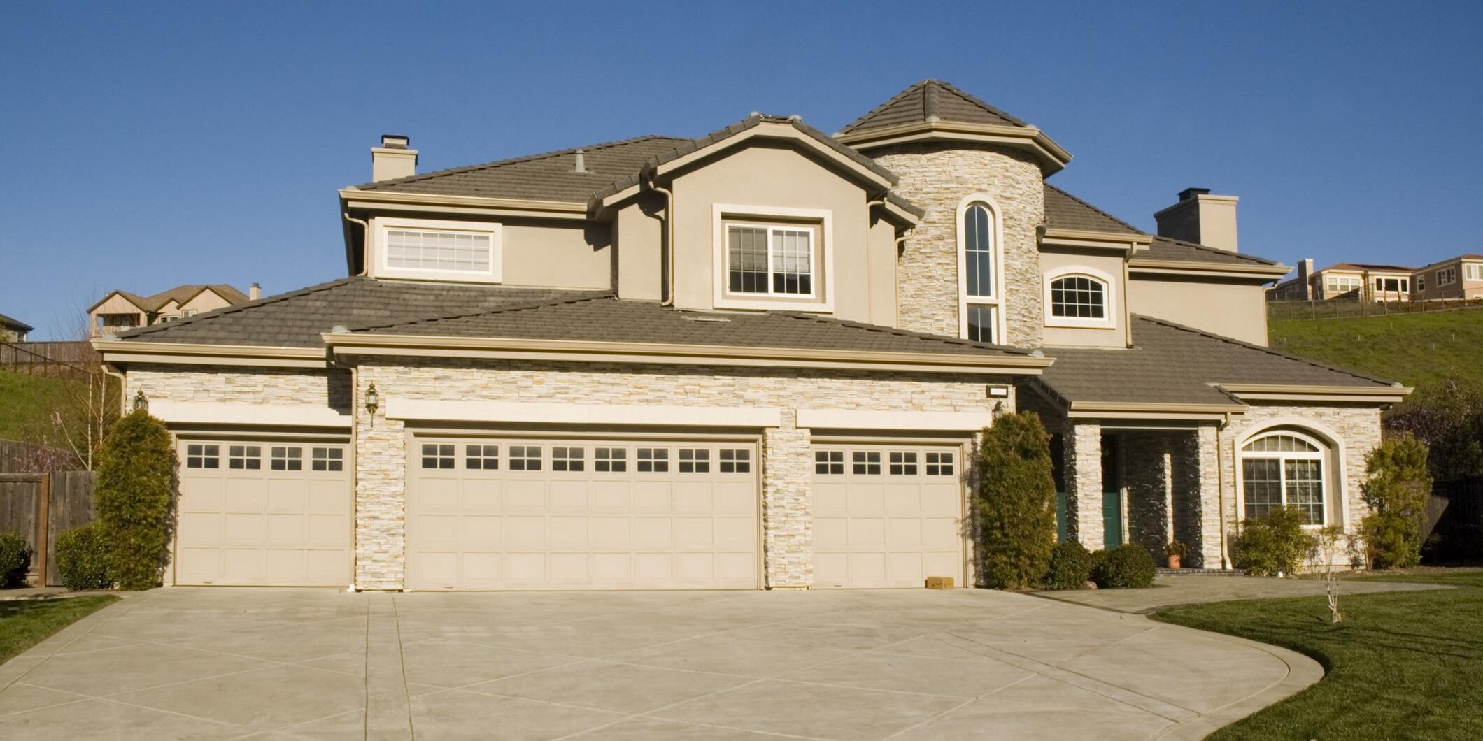 a house garage with concrete driveway